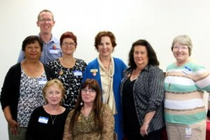 Interfaith Community Services Graduates and Staff with Greg Anglea, CEO